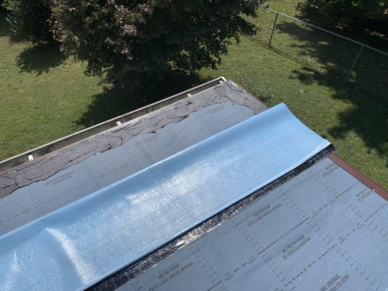 Roofing Cements Being Applied Around The Perimeter Of The Flat Roof