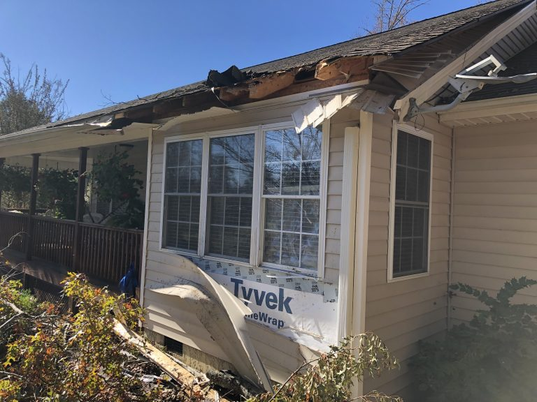 House Damaged By Tree During Storm