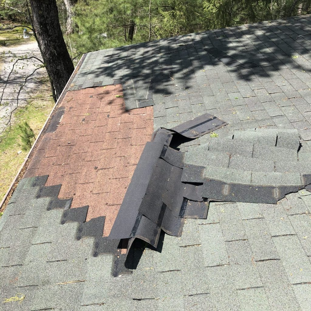 A roof in Hendersonville NC damaged by wind. This roof needs to be repaired